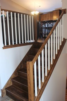 Stairs in elias dark oak wood finish and painted railings
