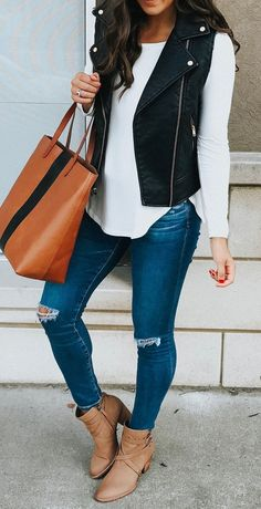 #winter #outfits white long-sleeve t-shirt, black vest, distressed blue jeans, brown chunky heels, and brown leather tote bag #womenclothingwinter
