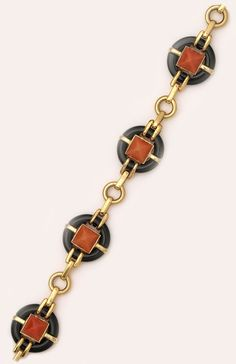 Wonderful sugarloaf-cut coral, onyx and gold bracelet.  Marzo, Paris. High style and very wearable.