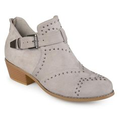 6979bdfc1db40 Rock the hottest trend this year in studded ankle booties by Journee  Collection. These ankle