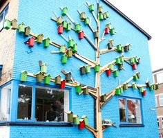 Artist and designer Thomas Dambo (previously) specializes in building family-friendly installations from upcycled materials. One of Dambo's many interactive projects is Happy City Birds, a ongoing series that lies at the intersection of street art and community development. The Danish artist builds