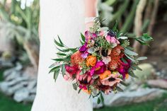 Vibrant colorful wedding bouquet: Photography : Randy + Ashley Studios Read More on SMP: http://www.stylemepretty.com/california-weddings/palm-springs/2017/02/24/high-school-sweethearts-palm-springs-wedding/