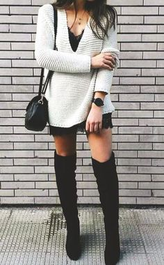 chunky sweater on top of a tunic dress and over the knee boots