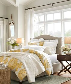 Master bedroom...love the bedding. Color pallette may work. Similar headboard color to what we're working with.