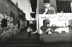 Larry Towell, Shati Refugee Camp, Gaza Strip, refugee child and graffiti, 2001