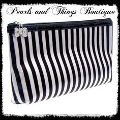Chic Striped MakeUp Bag Price is Firm                                                     Type	Cosmetic Cases Pattern Type	Striped Style	Fashion Main Material	Polyester Item Length	none Item Weight	50 g Closure Type	Zipper Item Width	19 cm Material Composition	Polyester Item Height	11.5 cm Shape	Trunk Brand Name	Other Type	Cosmetic Bags Size1	11.5*19cm Color	Black and White Bags Travel Bags