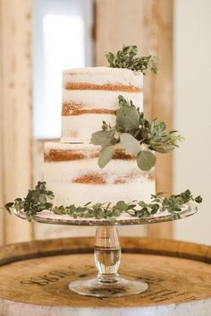 Dusted naked cake with succulent and ivy detail.   An Ivy-Covered Natural Style Inspiration Shoot   Love Inc. Mag   photo by Krystal Kast