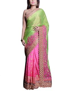 A striking half and half Saroj Jalan saree for parties or festive occasions. Half of the body of the saree is crafted from pink georgette bandhej while the drape and pallu are green. The parrot green georgette tissue drape has a pink satin patch work with zari embroidery along the border with scalloped ends. The bright pink raw silk blouse matches the pink patchwork on the saree and is adorned with golden embroidery.
