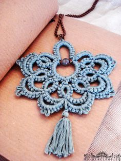 Bohemian statement tatted necklace with tassel/boho pendant necklace/bohemian necklace/statement jewelry/Tatted jewelry/frivolite/  Bohemian statement pendant with tassel in light grey. It is tatted with high quality 100% egyptian cotton .  Tatting is a knotted lace technique. Hundreds of knots are tied to form rings and chains. A bead is added one by one as the knots are tied.  Materials:100% high quality egyptian cotton ball chain 1 crystal glass bead bronze glass seed beads Size:3x4.3…