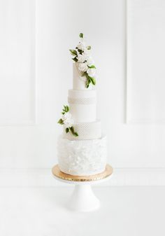 Jenna Rae Cakes in Winnipeg created this classic French-inspired wedding cake full of cascading blossoms. Canada's Prettiest Wedding Cakes For 2016 | Weddingbells