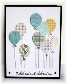 balloons from a variety of patterned paper, some are adhered flat, some are popped up. I drew the strings with a pen.