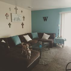 The livingroom. Brown, white and blue. Blue accent wall brings the room together so well!