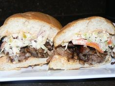Asian Pulled Pork, Carol's Coriander Slaw, Swiss Cheese, House Russian Dressing on a Toasted Bolillo Roll | Yelp
