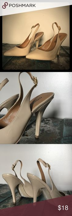 "Women's sling back stilettos These are the perfect ""must-have"" heels for any wardrobe! Creamy, neutral nude tone matches a variety of styles. Comfortable sling back adjustable strap with modest 3 inch heel. One minor imperfection on back of left heel, otherwise perfect condition. Only worn twice. Make an offer! Cosmopolitan Shoes Heels"