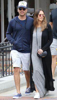 Dad style: Hubby Cash looked beachy in light shorts, a navy zip up and blue trucker hat....