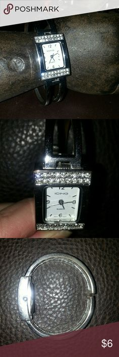 Silver Tone Bracelet Watch Icing hinged bracelet style watch.  Watch face lined top and bottom with two rows of clear crystals for that sparkle factor. Please note the top corners of the watch where the electroplating has thinned and shows copper (please see pic 2). Icing Accessories Watches