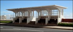 One of four Nautical Moderne style concrete seafront shelters on the two-tier seafront promenade at Eversfield Place, St Leonards On Sea [Sidney Little for Hastings BC, 1934]. Listed Grade II
