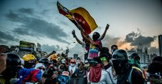 The Battle for Venezuela, Through a Lens, Helmet and Gas Mask - The New York Times