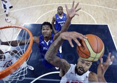 U.S. center Tyson Chandler (right) grabs a rebound in front of French forward Mickael Gelabale during the Men's Preliminary Round Group A match United States vs France at the London 2012 Olympic Games, July 29, 2012 in London.