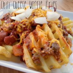 Chili Cheese Waffle Fries- the waffle fries stand up so well to the chili and make for easy eating!  Perfect Game day snack.  Made with Johnsonville's Chiliville Chili recipe and served over Ore-Ida Waffle Fries.  Definitely one I'll be making again!  #fall #JvilleKitchens #AllstarsJville #AllstarsOreIda @Allrecipes.com