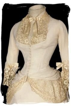 """""""This is a circa 1878 ivory silk bustle ball gown accented with the most…"""