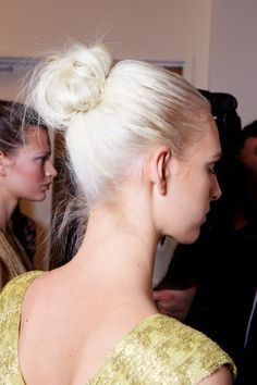 A simple solution for styling second-day strands is to fasten them into a twist. A wispy top knot as seen at DVF and Marchesa brings a casual ease to a gown, while a polished Prada chignon or a braided Dolce & Gabbana bun secured at the neck lends elegance even to a blouse and jeans. Pictured: Diane von Furstenberg