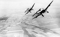 Two German Luftwaffe Ju 87 Stuka dive bombers return from an attack against the British south coast, during the Battle for Britain, on August 19, 1940. (AP Photo)