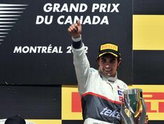 Third place finisher Sauber Ferrari driver Sergio Perez of Mexico holds up the trophy on the podium after the Canadian Formula One Grand Prix on June 10, 2012