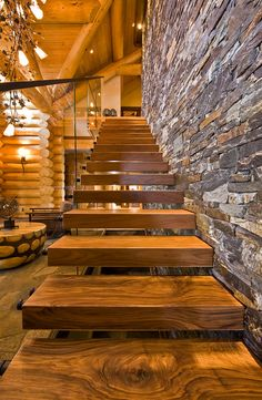 Fascinating Tips when Designing Luxury Log Home Plans: Cool Floating Steps Wooden Indoor Staircase Design Idea Equipped With Glass Balustrade Design Idea Equipped With Stone Veneer Ideas Plan Unit Stone Veneer ~ HKSTANDARD Architecture Inspiration