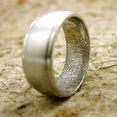 love this for his wedding band - her fingerprint inside :)