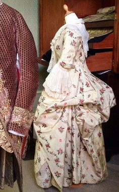 Side view, robe à la Polonaise, 1775-80. Cream silk comprise a wide ribbed satin stripe fabric, brocaded with floral sprays in red, pink, green, black, pale blue and yellow. (Charles Paget Wade Collection stored at Berrington Hall)