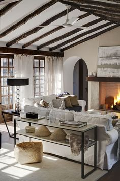 Less is better in this cabin living room.  Dark wood trim and washed white made the room.
