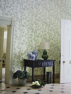 Romey's Garden Wallpaper A floral wallpaper featuring a trail of flowering peony branches in cream, green and taupe on an aqua background.