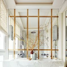 A Paris Apartment's Luxuriously Layered Master Bath featured in AD Interior Architecture: Champeau & Wilde Photo: Ricardo Labougle