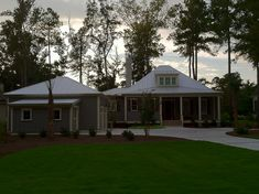 The Bermuda Bluff Cottage by Allison Ramsey Architects built at Oldfield in Okatie, South Carolina. This plan is 2007 Heated Square Feet, 3 Bedrooms and 3 Bathrooms. Carolina Inspirations Book I, Page 19, C0002.