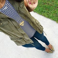 We love this military styled vest paired with the navy stripe tee and gold long-chain necklace.   cc: @tatisbonilla