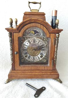 Ends shortly on eBay with Low bids this Small Warmink 8 Day 9.4 Inch Oak Bracket Clock With Rolling Moon Phase
