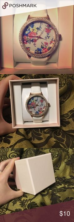 Floral Design Watch Floral design watch. Never used! Still in original box. White strap. Hands are not moving. Needs to be wound. Accessories Watches