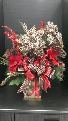 Cheeta Chrstmas tabletop with brown and red ribbon....Robin Evans