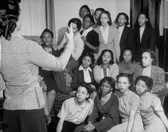Female students singing at a meeting of the African-American sorority Delta Sigma Theta on the campu