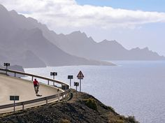A cyclist leans into a turn on a steep mountain road in the Canary Islands. Located in the Atlantic Ocean 620 miles south of mainland Spain, these stark, volcanic islands are only 71 miles from the African coast. The islands serve as a budget sun-and-sea vacation destination for many northern Europeans. Photograph by Martin Kirchner, laif/Redux, August 2, 2014