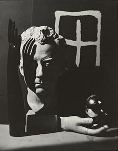 Man Ray; Self portrait, Still life with rayograph and surrealist objects (Gelatin Silver Print), 1932.