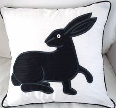 ICONIC silk appliqued cushion can be purchased from CREATIVATIONS-CHELSEA