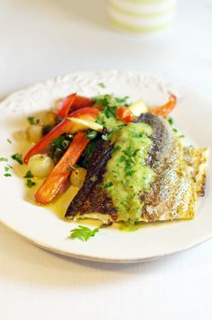 Grilled perch with vegetables and lemony garlic sauce