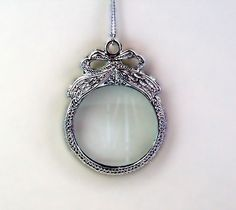 Hey, I found this really awesome Etsy listing at http://www.etsy.com/listing/61594009/magnifying-glass-necklace-with-bow
