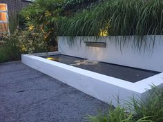 Stucco pond with waterfall element Outdoor Water Features, Pool Water Features, Water Features In The Garden, Fish Ponds Backyard, Small Backyard Landscaping, Backyard Patio, Contemporary Water Feature, Pond Waterfall, Water Walls