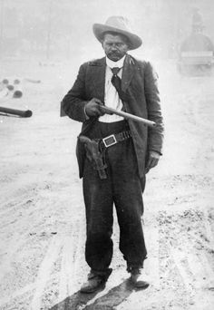 Real - Benjamin J. Hodges, a Mexican Black man, poses in Dodge City (Ford County) Kansas, with a sawed off shotgun and a pistol in a holster belt - ... JamesAZiegler.com