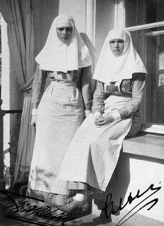 """otmacamera: """" Grand duchess Tatiana Nikolaevna and Grand duchess Olga Nikolaevna in nursing uniform, circa 1916 """""""