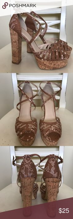 Shoe dazzle strapy snake skin heels! I absolutely love these heels and I want to keep them but they are too big for me 😞 size 10 but fits as least as 10 1/2 , platform 1 1/2 inches , heel 5 1/2 inches. Still absolutely brand-new only tried on! Beautiful neutral snake skin colors and cork platform and heel ! Shoe Dazzle Shoes Heels