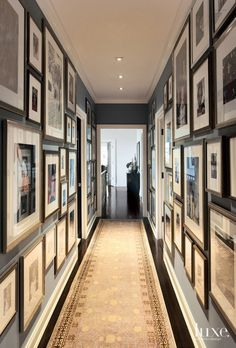Designer Neal Beckstedt rummaged through cartons of family photos in the attic in order to create a statement-making memory wall in the hallway.